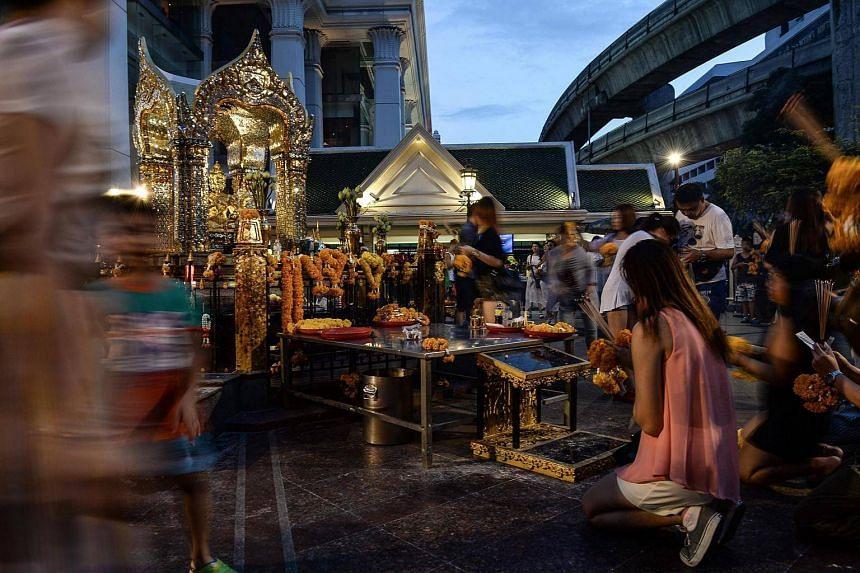 People praying at the Erawan Shrine in Bangkok, on August 20.