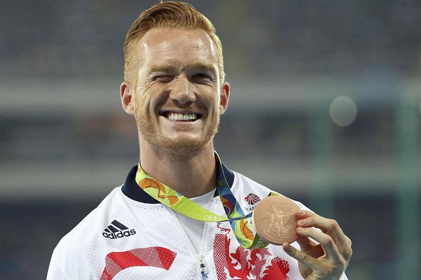 Greg Rutherford poses with the bronze medal at the Rio Olympics.