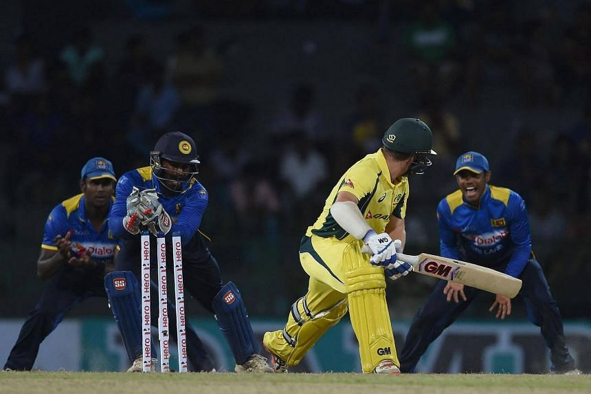 Sri Lankan wicketkeeper Kusal Perera (second from left) dismisses Australian cricketer Travis Head (second from right) during the cricket match between Sri Lanka and Australia, on August 21.