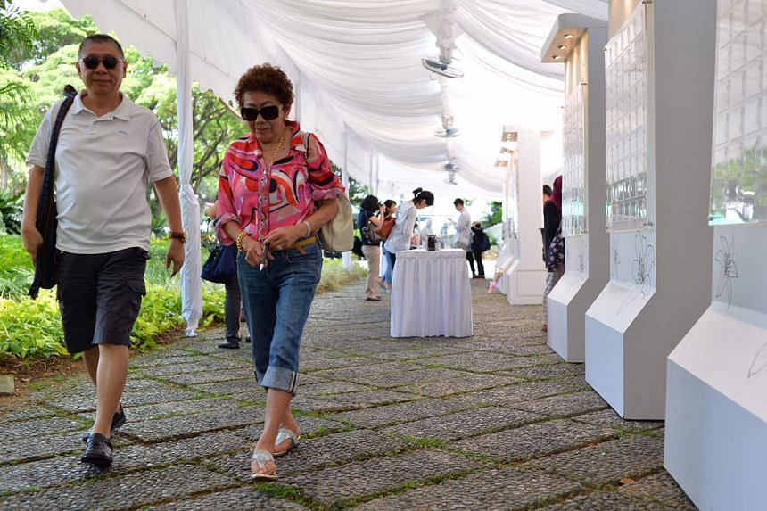 """Lady Colette Chow (right), wife of Sir Henry Chow, Honorary Consul-General of Singapore in Papua New Guinea, at the Istana with her friend Mr Lawrence Low (left), 62, a retiree. She described Mr S R Nathan as """"a down-to-earth and humble man""""."""