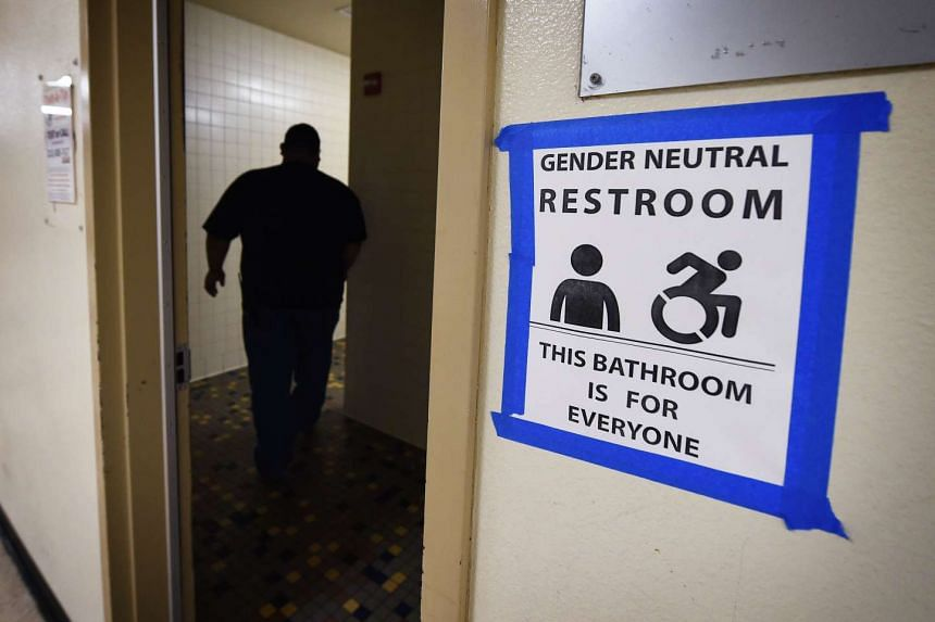 Signs posted outside the Santee High School's restrooms indicate a gender neutral policy at their campus in Los Angeles.