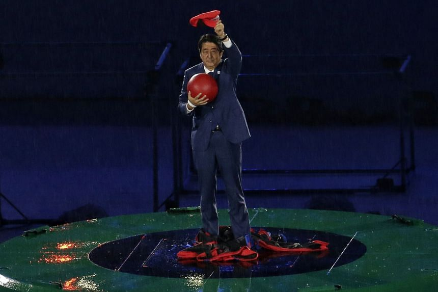 "Mr Abe emerging from a drainpipe dressed as Super Mario during the closing ceremony at the Maracana Stadium. He said: ""I wanted to show Japan's soft power to the world with the help of Japanese characters."""