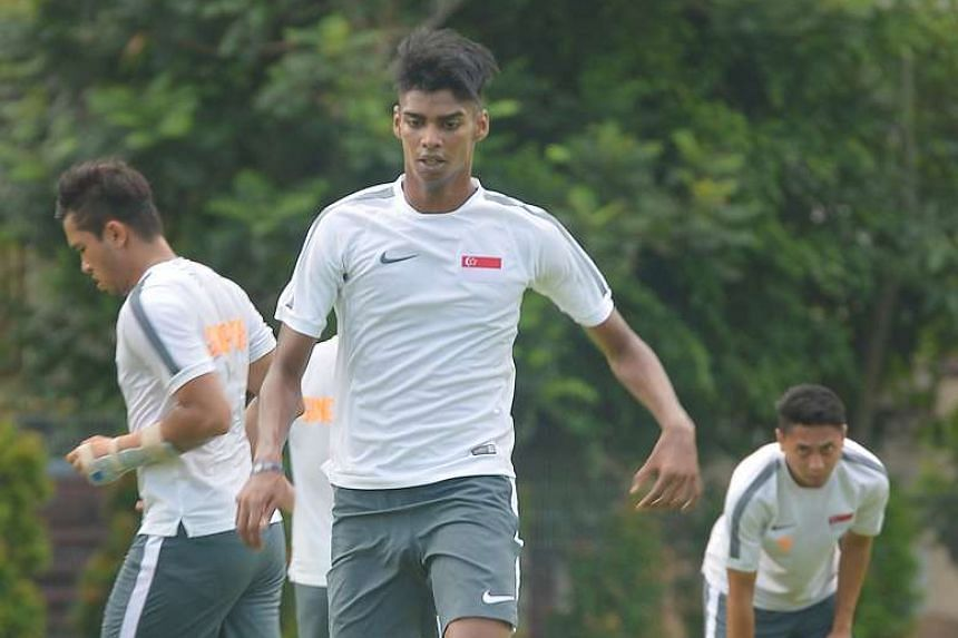 Striker Iqbal Hussain (centre) in a training session on June 2, 2015.
