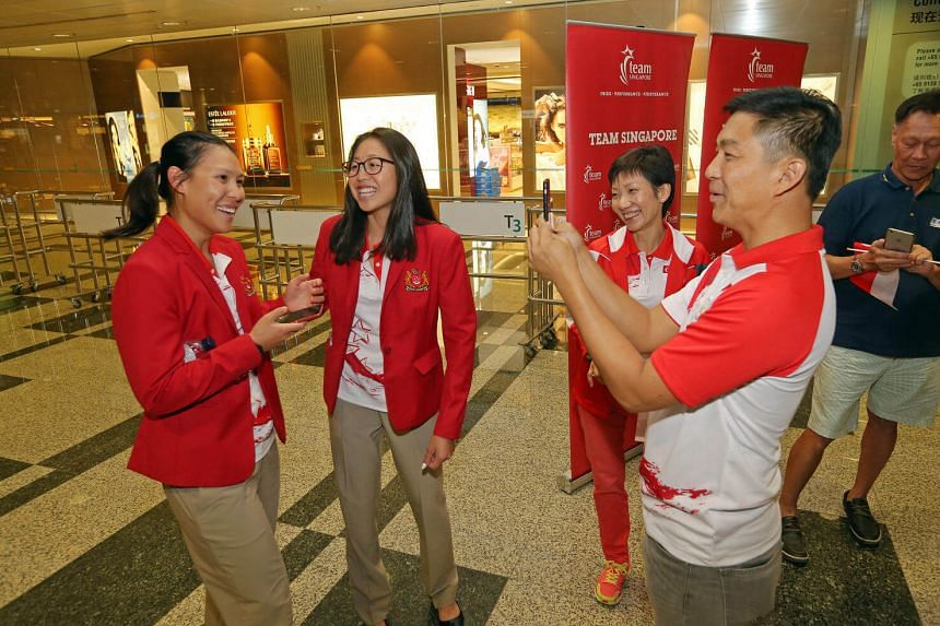 Family and friends of athletes, (right) Mr Tan Chuan Jin and Ms Grace Fu welcome sailors including (left) Sara Tan and (2nd from left) Amanda Ng, as Team Singapore's final batch of Olympic athletes return from Rio at Changi Airport Terminal 3 on Augu
