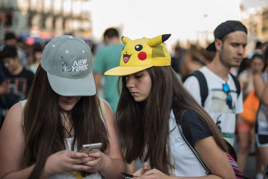 Pokemon Go fans playing the game during a mass gathering in Madrid, Spain.