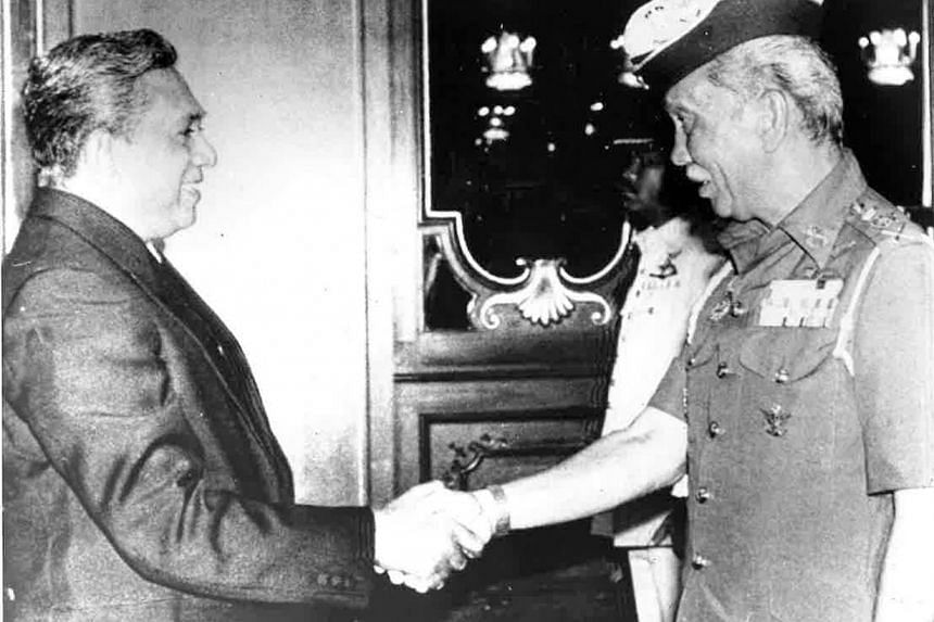 The Yang di-Pertuan Agong Sultan Iskandar shaking hands with Mr S R Nathan in 1988 after the Singapore High Commissioner to Malaysia presented his credentials to the King at the Istana Negara in Kuala Kumpur.