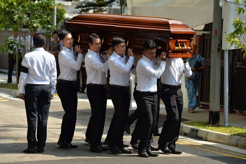 The casket of former president S R Nathan being carried into his home on Aug 23, 2016.