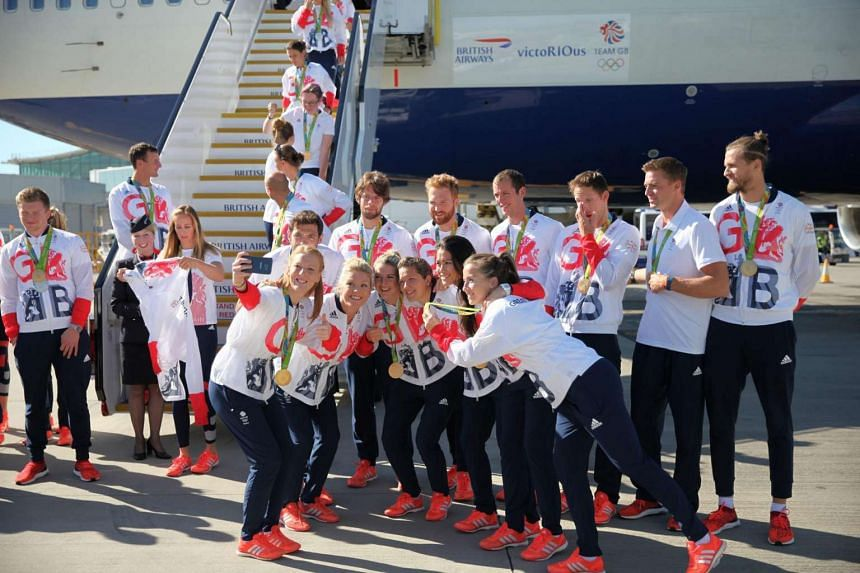 British Olympic team arriving at Heathrow Airport, London.