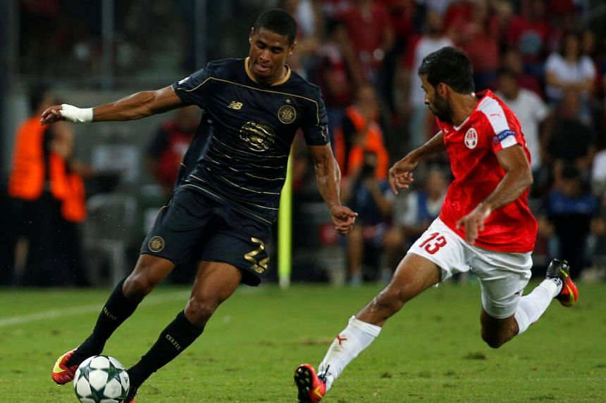 Celtic's Saidy Janko and Hapoel Be'er Sheva's Ofir Davidzada in action during the match.