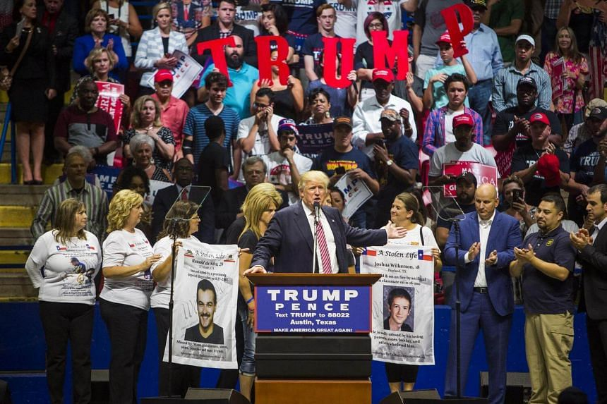 Donald Trump brings border patrol members as well as mothers whose sons had been killed by immigrants to the stage during a rally at the Travis County Exposition Center in Austin, Texas on Aug 23.
