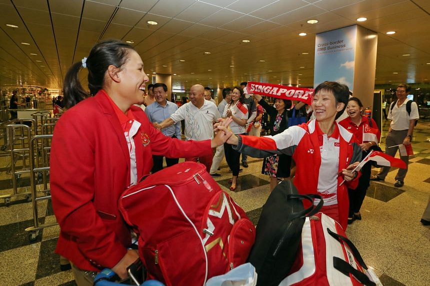 Family and friends of athletes, and Ms Grace Fu welcome sailors including (left) Sara Tan, as Team Singapore's final batch of Olympic athletes, the sailing team, returns from Rio at Changi Airport Terminal 3 on August 24.