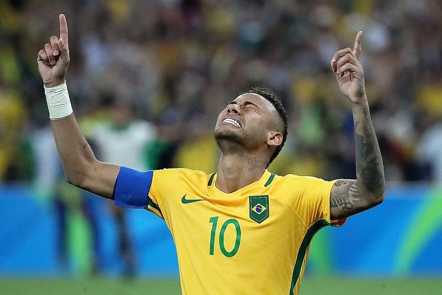 Neymar celebrates scoring the winning penalty that gave Brazil their first gold medal in Olympic men's football.