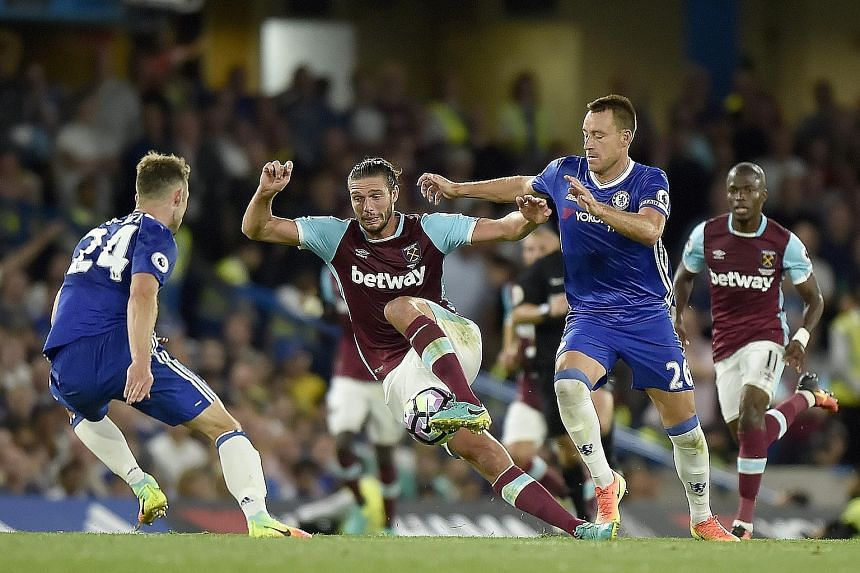 Chelsea skipper John Terry (right) vies for the ball with West Ham striker Andy Carroll in the Blues' 2-1 win at Stamford Bridge this month.
