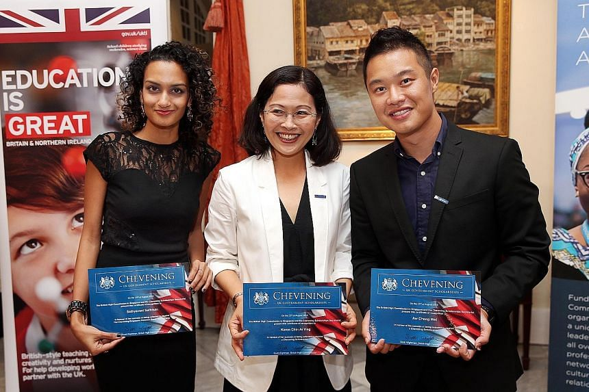 This year's Chevening Scholarship recipients (from left) Ms Sathyavani Sathisan, 32; Ms Karen Chin Ai Ying, 41; and Mr Aw Cheng Wei, 27, at a ceremony in Eden Hall yesterday. The bond-free scholarships are awarded to emerging leaders in their field f