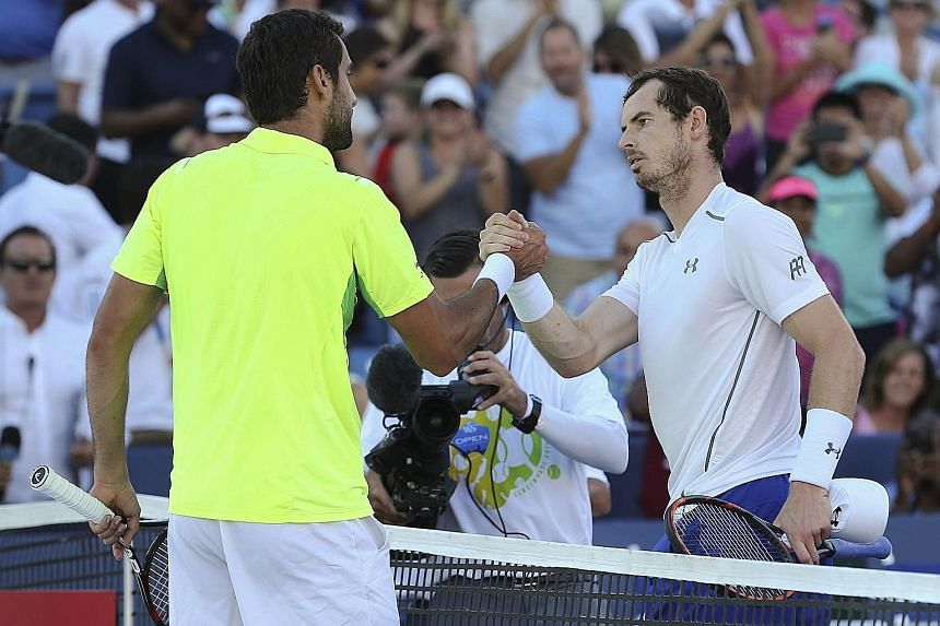 Andy Murray (right) shaking hands with Marin Cilic after the Cincinnati Masters final. The Croatian ended Murray's 22-match winning streak.