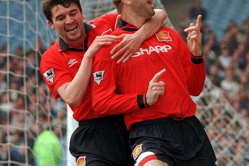Midfielder Roy Keane (left) and striker Eric Cantona celebrate a goal during Man United's 3-2 win over Man City in the 1995-96 season. The duo were both strong physically and technically, and observers believe Paul Pogba can dominate the midfield lik