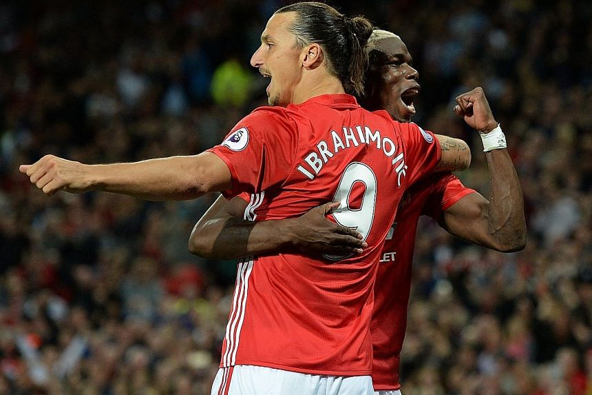 Manchester United striker Zlatan Ibrahimovic celebrates with midfielder Paul Pogba after scoring the team's second goal against Southampton last week. Both players were making their home debuts but were not afraid to impose themselves as leaders on t