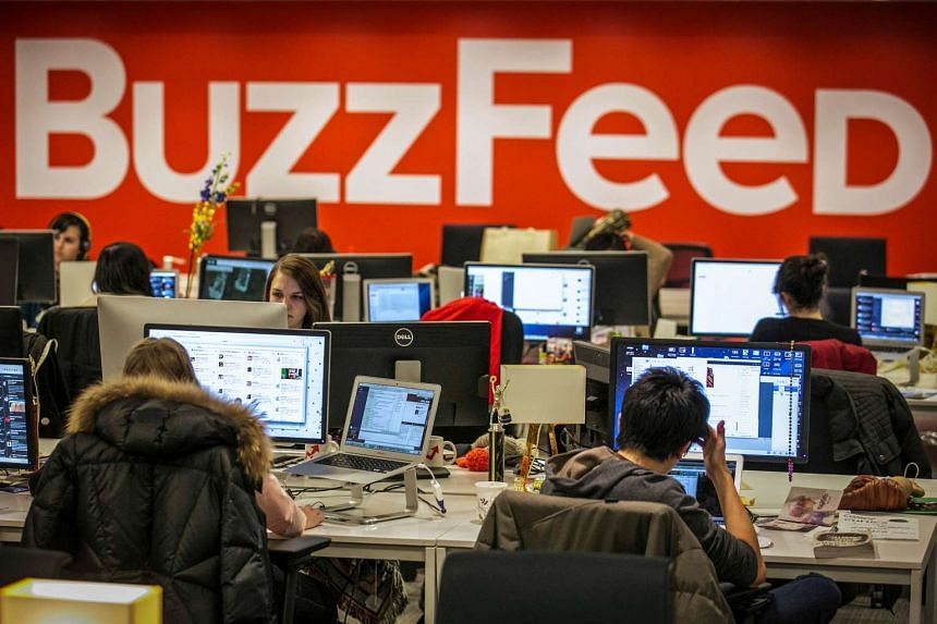 BuzzFeed employees work at the company's headquarters in New York on Jan 9, 2014.