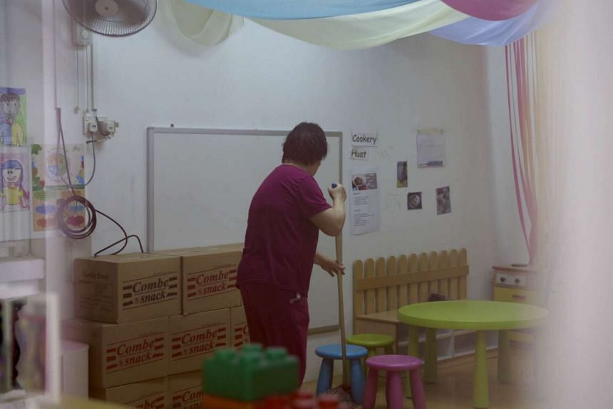 A cleaner mopping the floor at Little Greenhouse after a teacher there was diagnosed with latent TB.