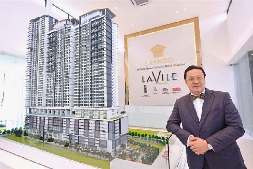 Eng posing with a model of Lavile Kuala Lumpur, which will be home to Lee and his family upon its completion in 2020.