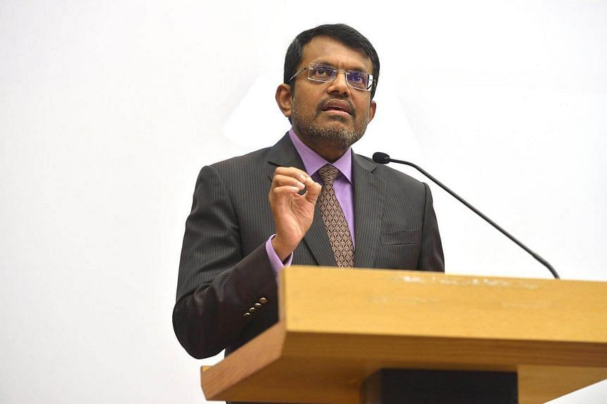 MAS managing director Ravi Menon speaking at the fintech conference at the Singapore Management University on Aug 19, 2016.