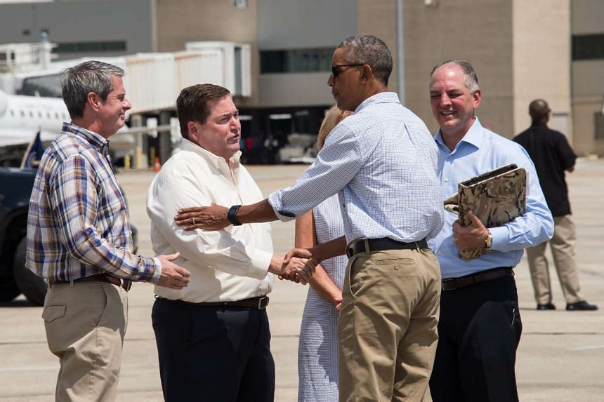 Obama is greeted by Louisiana politicians and officials as he arrives in Baton Rouge, Louisiana, on Aug 23, 2016.