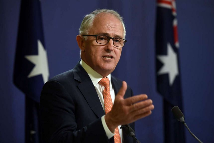 Australia's Prime Minister Malcolm Turnbull declares victory for the ruling conservatives at a press conference in Sydney on July 10.
