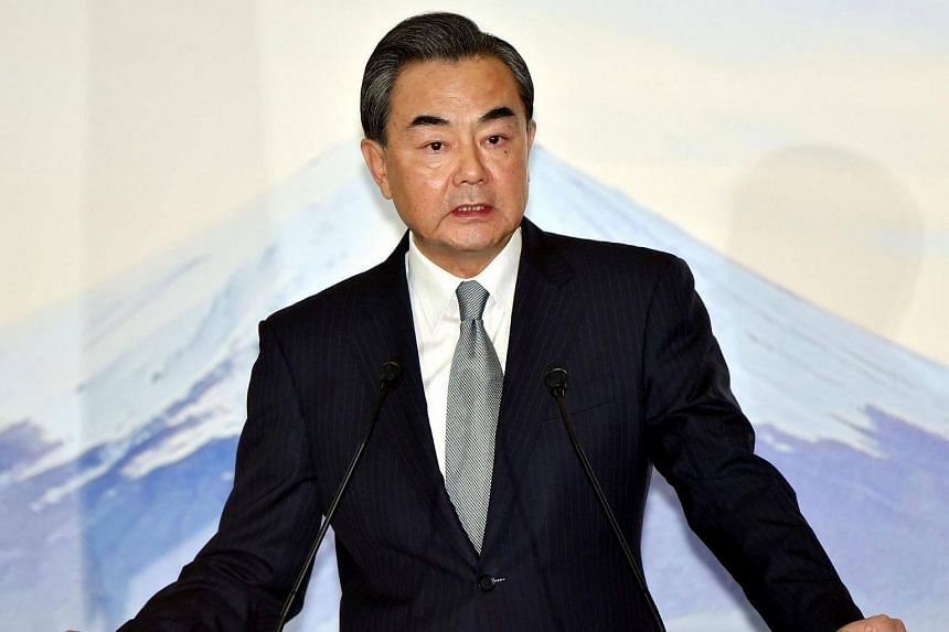 Chinese Foreign Minister Wang Yi reading his statement after a trilateral meeting with Japan and South Korea in Tokyo on Aug 24, 2016.
