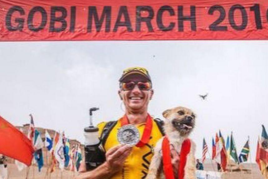 Mr Dion Leonard with Gobi after the ultramarathon through the Gobi desert.