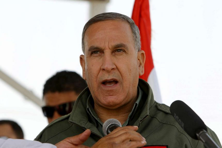 Iraqi lawmakers have voted to impeach Defence Minister Khaled al-Obeidi over corruption allegations.