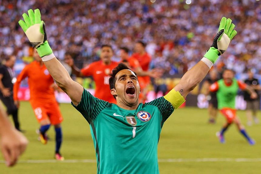 Chile goalkeeper Claudio Bravo celebrates after defeating Argentina to win the Copa America Centenario Championship on June 26, 2016.