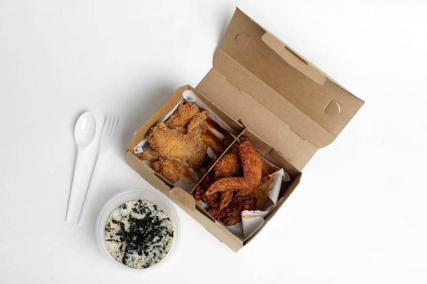 Chicken wings in a takeaway box meant for delivery.