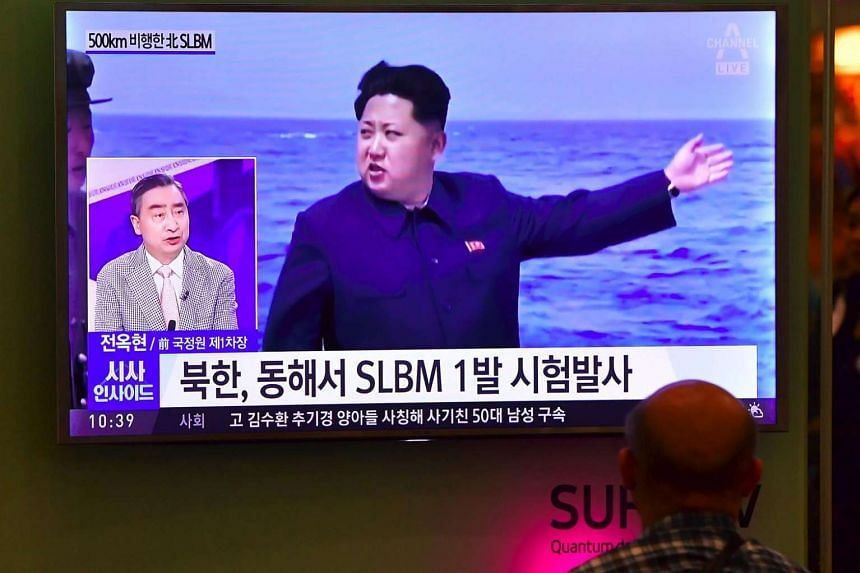 A man watching a file footage of North Korea's leader Kim Jong Un during a missile launch at Incheon airport, west of Seoul, on Aug 24, 2016.