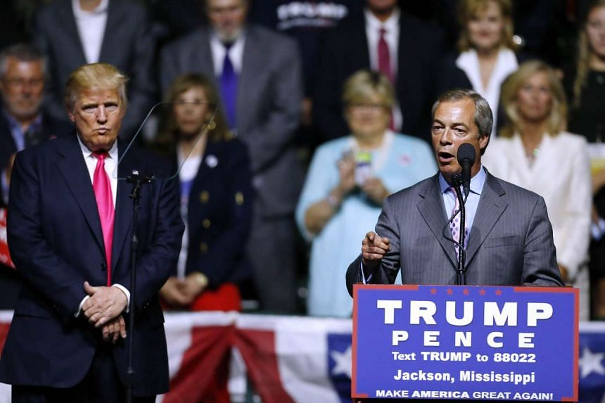 Republican Presidential nominee Donald Trump (left) listening to former United Kingdom Independence Party leader Nigel Farage speak during a campaign rally at the Mississippi Coliseum on Aug 24, 2016 in Jackson, Mississippi. Thousands attended to lis