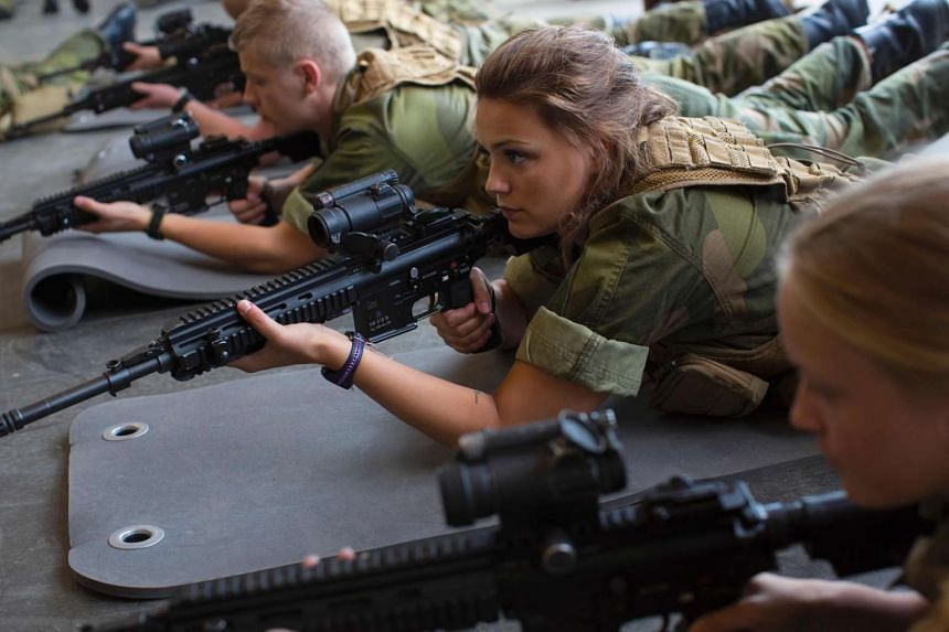 Female army recruits attending a base training at the armored battalion in Setermoen, northern Norway on Aug 11, 2016. Norway has become the first NATO member to have compulsory conscription for women as well as men in the army. Recently, the first b