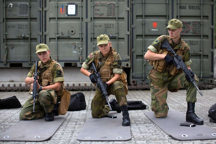 Army recruits attending a base training at the armored battalion in Setermoen, northern Norway on Aug 11, 2016. Norway has become the first NATO member to have compulsory conscription for women as well as men in the army. Recently, the first batch of
