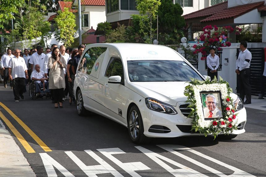 The casket bearing the body of former President S R Nathan leaves his house at Ceylon Road for Parliament house on Aug 25.