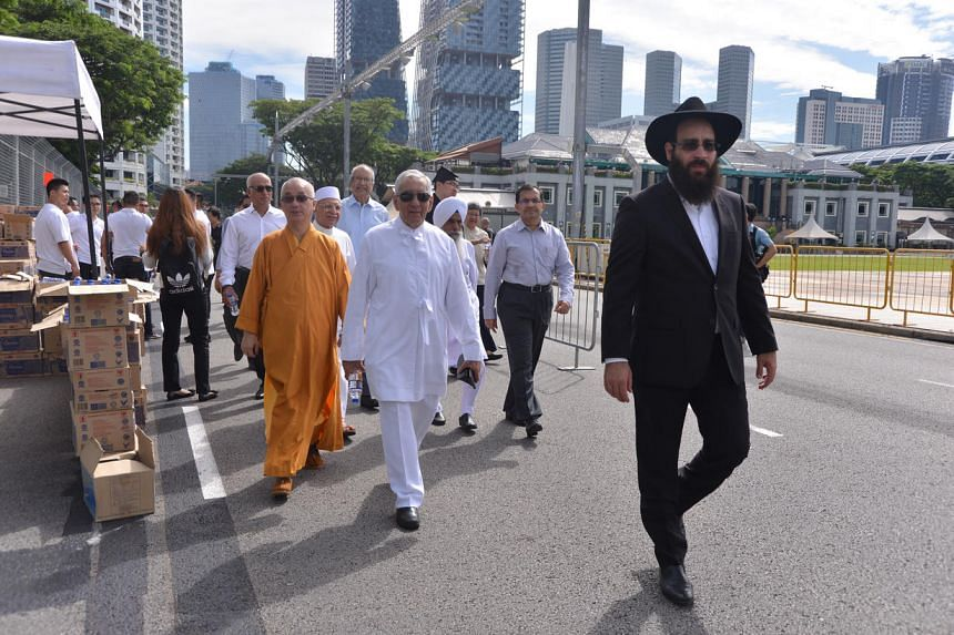 Religious group leaders walking towards Parliament House to pay their last respects to Mr S R Nathan.