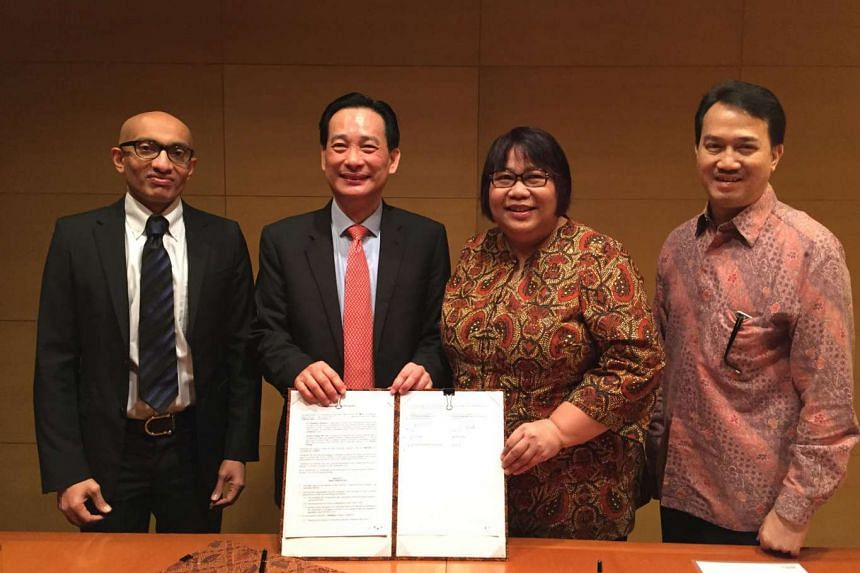 (From left) Ambassador Anil Kumar Nayar, Singapore's Ambassador to the Republic of Indonesia; Mr Seah Moon Ming, Group CEO of Pavilion Energy; Ms Yenni Andayani, New and Renewable Energy Director of PT Pertamina; and Mr Djohardi Angga Kusumah, Seni