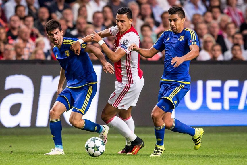 Rostov's Christian Noboa (right) and Denis Terentjev fight for the ball with Ajax Amsterdam's Anwar El Ghazi (centre) during the UEFA Champions League play off match in Amsterdam on Aug 16, 2016.