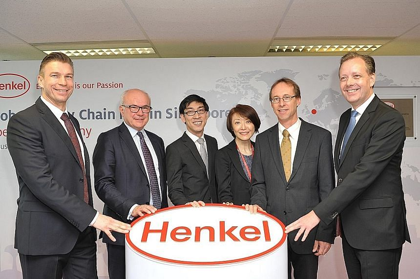 At the opening ceremony of Henkel's global supply chain hub in Singapore yesterday were (from left) Mr Rolf Knoerzer, Henkel vice-president operations & supply chain asia pacific; Mr Bertrand Conqueret, Henkel president global supply chain; Mr Chan I