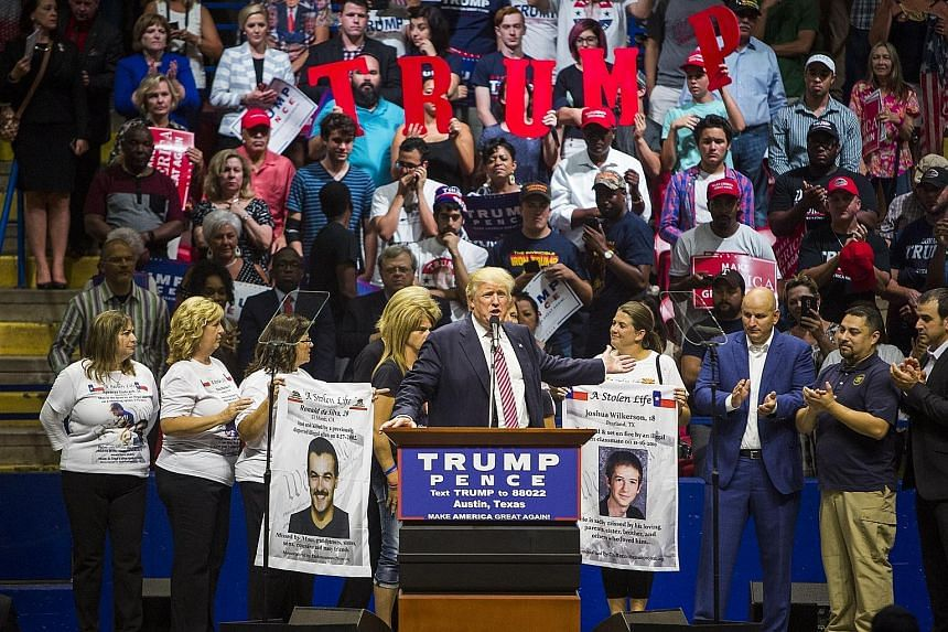 Border patrol members and women whose children were killed by immigrants share the stage with Mr Trump in Texas.