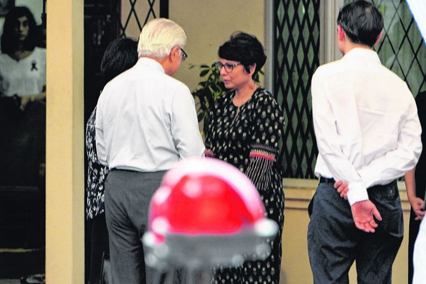 President Tan and his wife speaking to Mr Nathan's daughter Juthika Ramanathan at the family's Ceylon Road home, where they paid their respects. Visitors writing tributes to Mr Nathan on condolence boards at the Istana. People from all walks of life