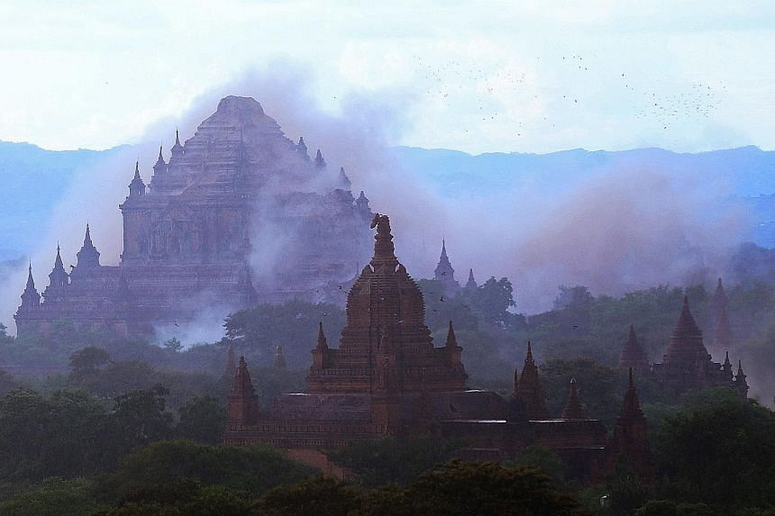 The ancient Dhammayangyi temple is shrouded in dust after a 6.8-magnitude earthquake hit Bagan in Myanmar yesterday.