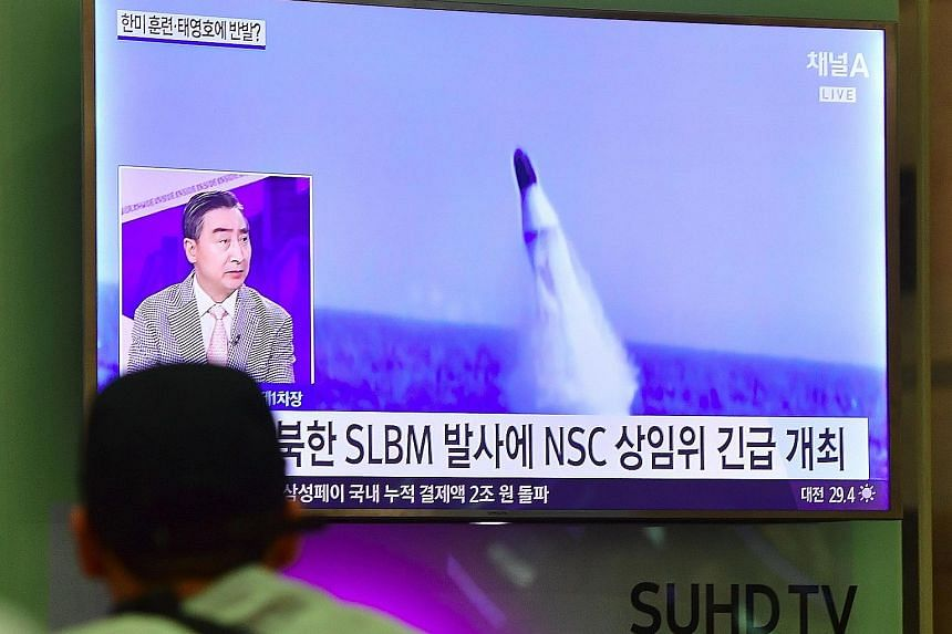 A television news report in South Korea yesterday showing file footage of a North Korean missile launch.