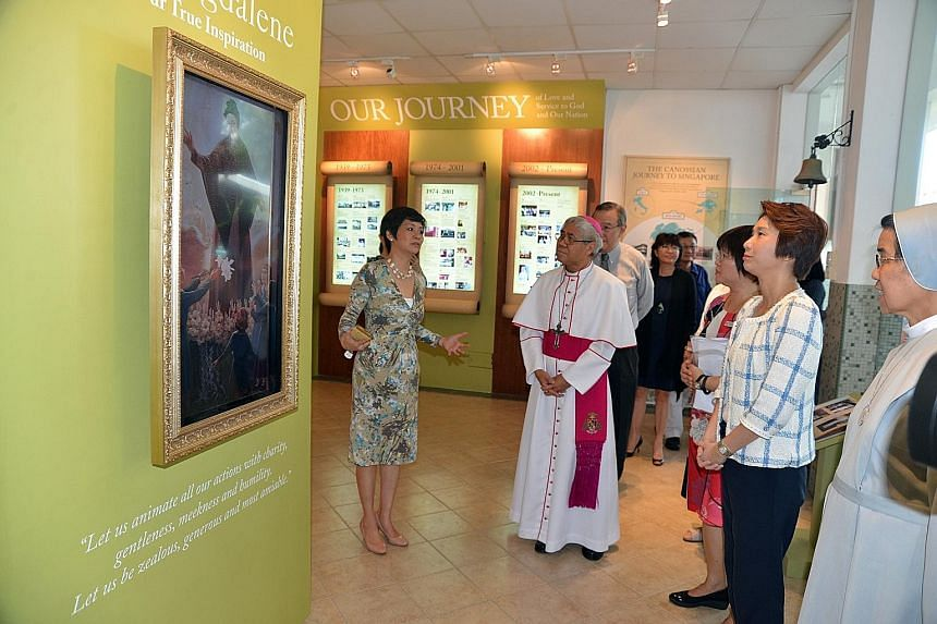 Front row, from left: Canossian alumni president Ms Veronica Tan, Archbishop William Goh, CCPS principal Ms Grace Tan, Ms Low Yen Ling and Sister Theresa Seow touring the Canossa Heritage Gallery. CCPS celebrated its 75th anniversary and its official