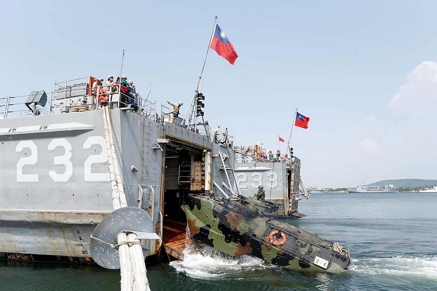A handout photo showing an Amphibious Armoured Personnel Carrier being loaded onto a warship in the Han Kuang 32 military drill. The five-day annual exercise began on Monday.