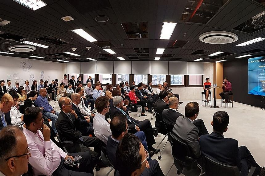 MAS managing director Ravi Menon speaking to an audience at the launch of Looking Glass @ MAS. The facility, which is in the MAS building, will allow financial institutions and start-ups to experiment with fintech and facilitate consultations between
