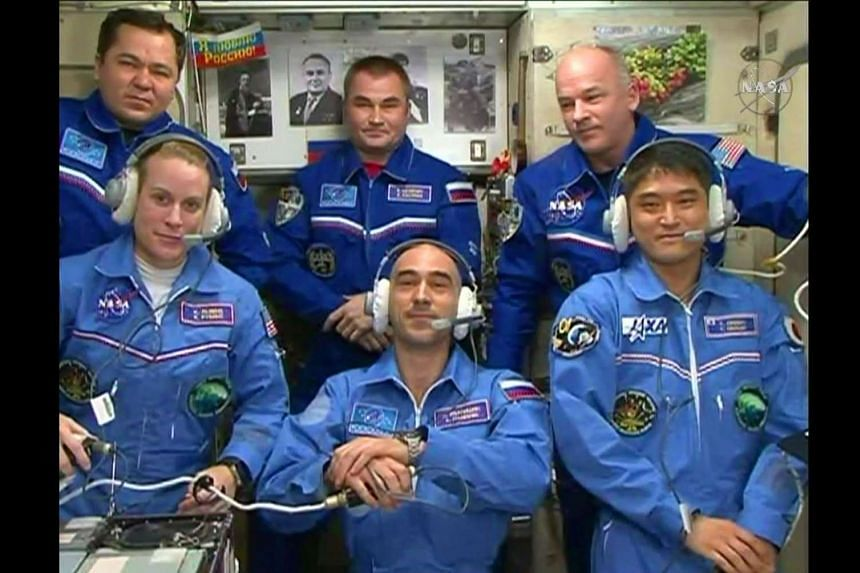 Commander Jeff Williams (back row, far right) is pictured with ISS team members on July 9, 2016 in an image from Nasa TV.