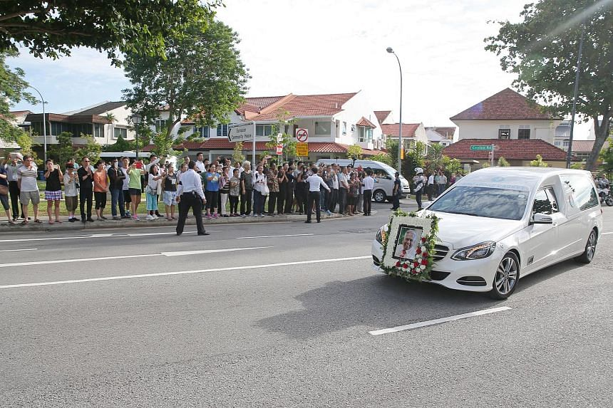 The casket bearing the body of former president S R Nathan leaving his house at Ceylon Road for Parliament House on Aug 25.